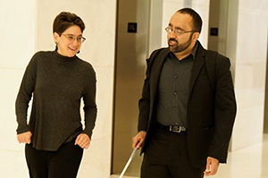 Photo of Amir Rahimi walking with a colleague.