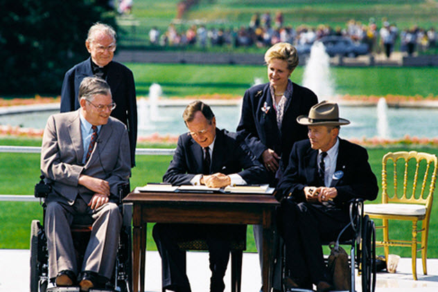 President George H.W. Bush signs the Americans with Disabilities Act (ADA) into law.
